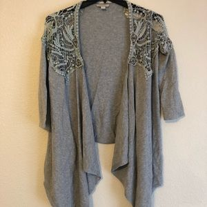 Grey sweater with lace and studded shoulders
